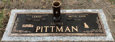 companion bronze headstone on granite base with dogwood design and cat and semi truck car carrier emblems