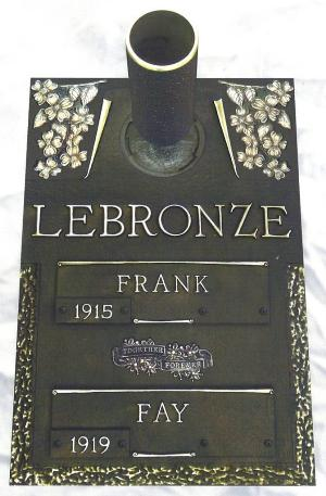 double interment bronze headstone on granite base with dogwood rocklawn design and flower vase