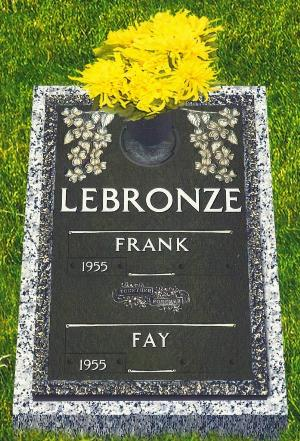 double interment bronze headstone on granite base with rose dogwood and flower vase