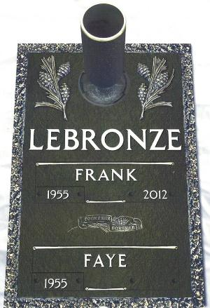 double interment bronze headstone on granite base with pine design and flower vase
