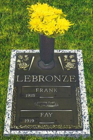 double interment bronze headstone on granite base with rocklawn rose design and flower vase