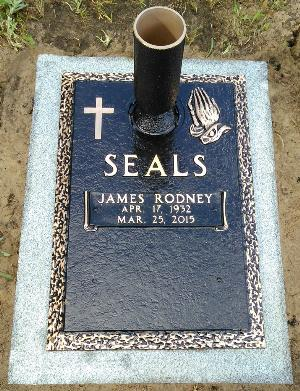 double interment bronze headstone on granite base with cross and praying hands design and flower vase