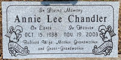 individual gray granite headstone with praying angels emblems
