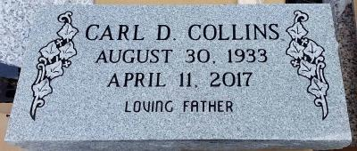 single gray granite headstone with ivy leaves design