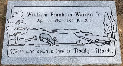 gray granite headstone with deer on landscape scene