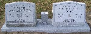 gray granite companion slant headstone with wild roses design and engraved flower vase