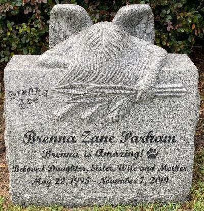 individual slant granite headstone with weeping angel