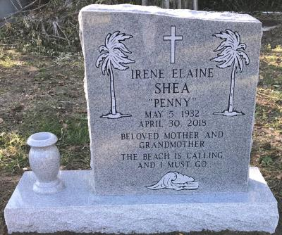 single gray granite upright headstone with beach theme