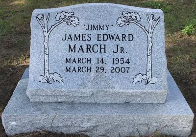 gray granite slant upright headstone with tree design
