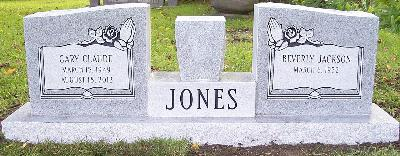 gray granite winged companion upright headstone with flower vase