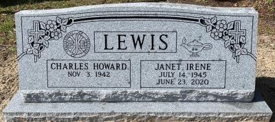 gray granite companion slant headstone with professional engineer and registered nurse emblems