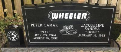 black granite companion upright headstone with the Pittsburgh Steelers logo and custom font surname